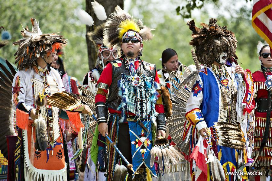 Pictured: Members of the Kahnawake Tribe attend a yearly powwow