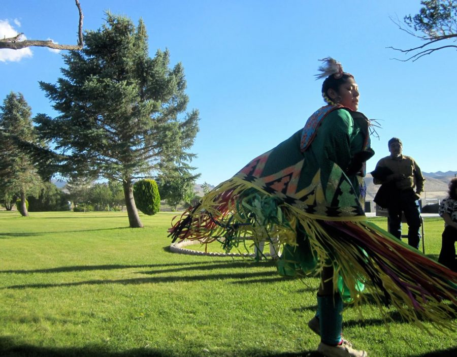 Pictured: A member of the Yerington Paiute Tribe performs a dance at a local dedication ceremony