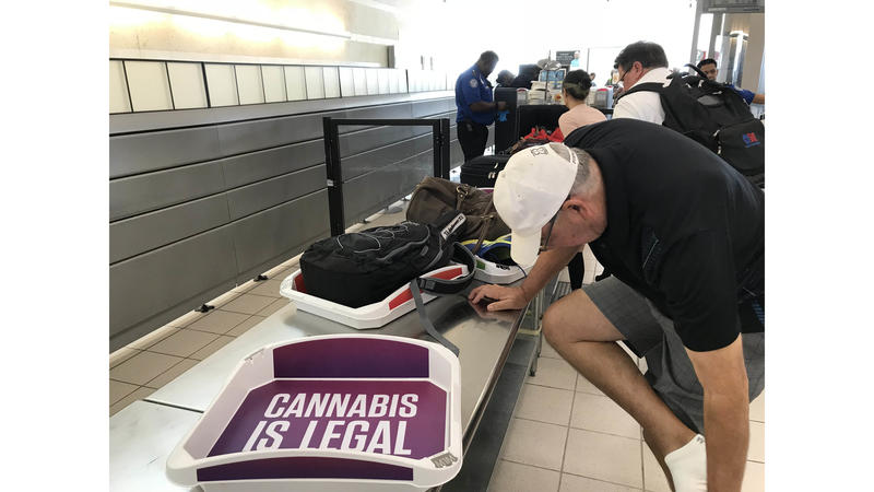 Cannabis ads appear in TSA checkpoint trays at Ontario International Airport